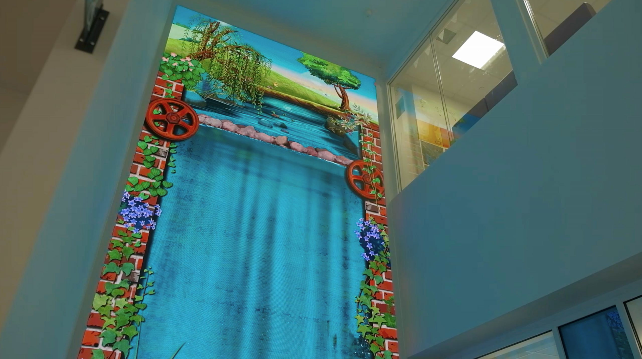 7 meter tall interactive waterfall with animated landscape on to
